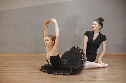 A Young Ballerina Training with Hear Teacher