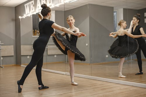 Young Ballerina Dancing with Her Teacher