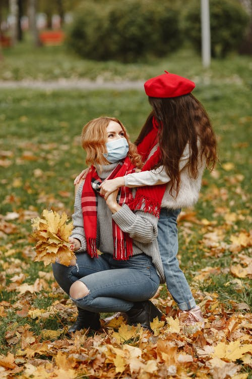 Woman In Red Hat At The Park With A Little Girl