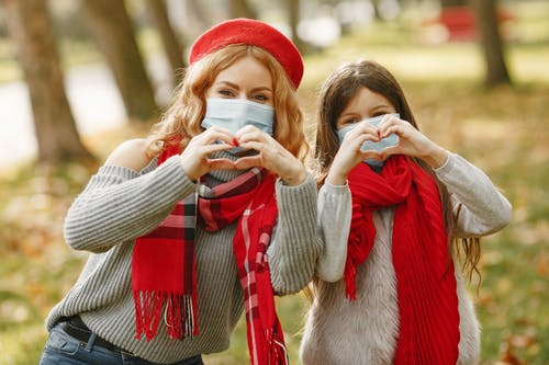 Woman And A Girl Wearing Red Scarves