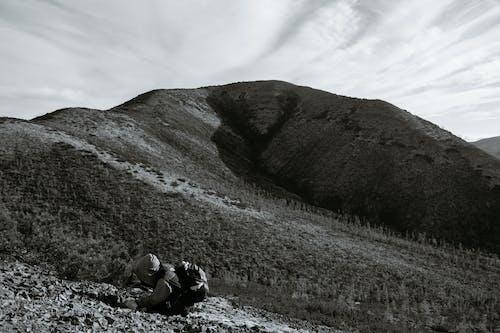 Anonymous traveler in mountainous terrain