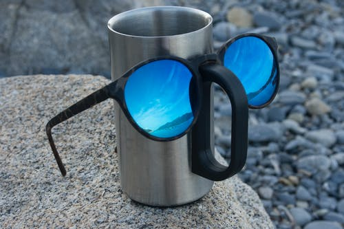 Free stock photo of blue glasses, blue sky, coffee mug, eye glasses