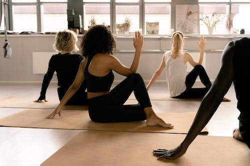 3 Women in Black Tank Top and Black Leggings Doing Yoga