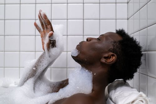 Man in Bathtub With Water