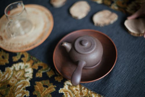 Small ceramic teapot placed on rug during ceremony