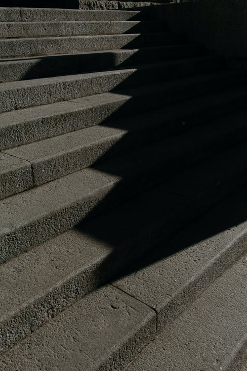 Stone steps in sunlight on street