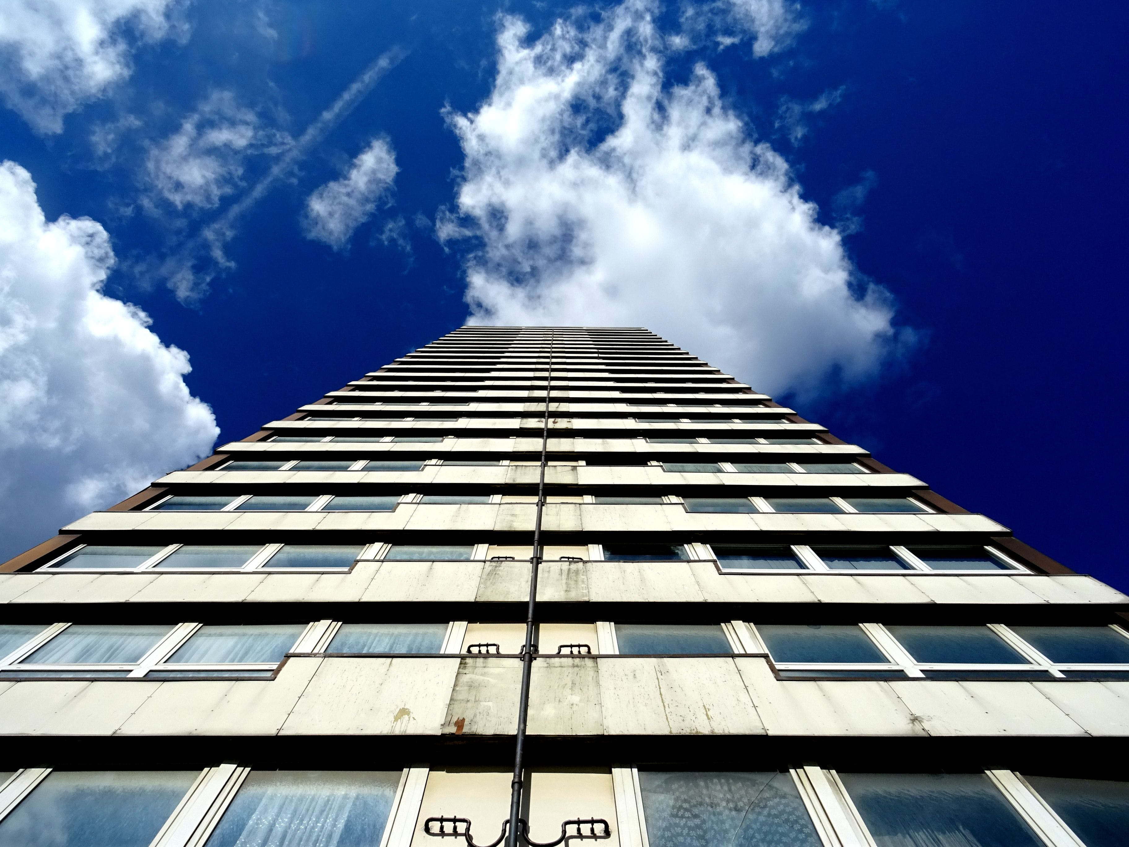 Low Angle Photography of White High-rise Building