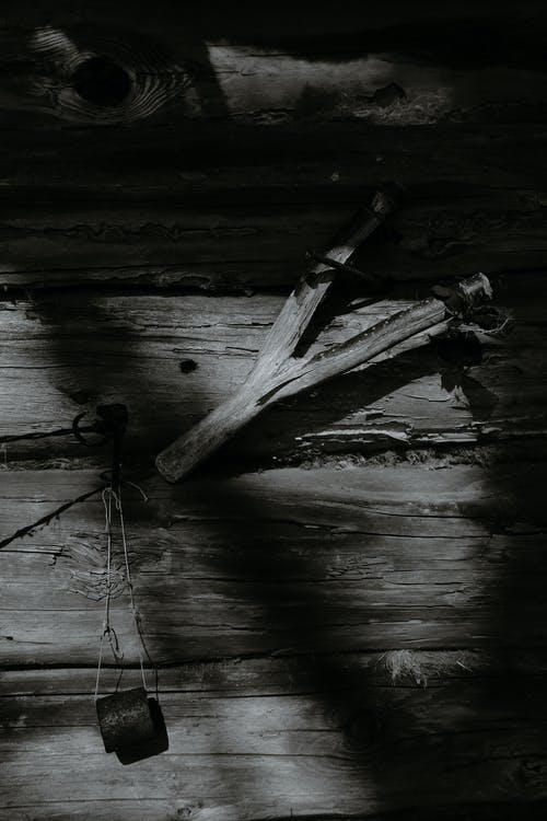 Wooden tool hanging on wall