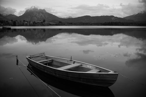 White and Black Boat on Lake