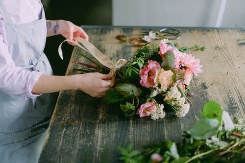 A Person Arranging Flowers