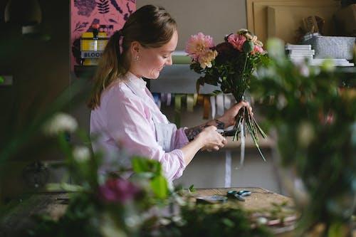 A Woman Arranging Florist