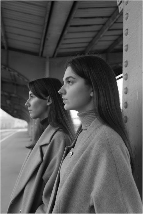 Young women standing on railway platform