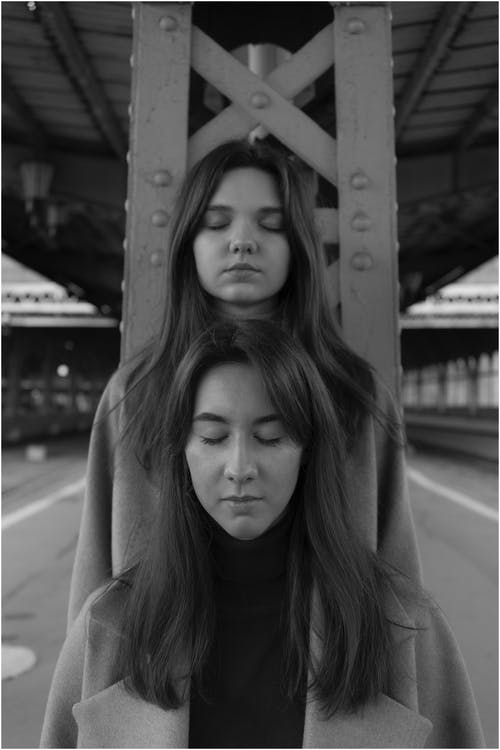 Young women with closed eyes on platform