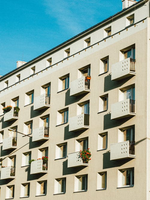 Facade of geometric residential building under blue sky