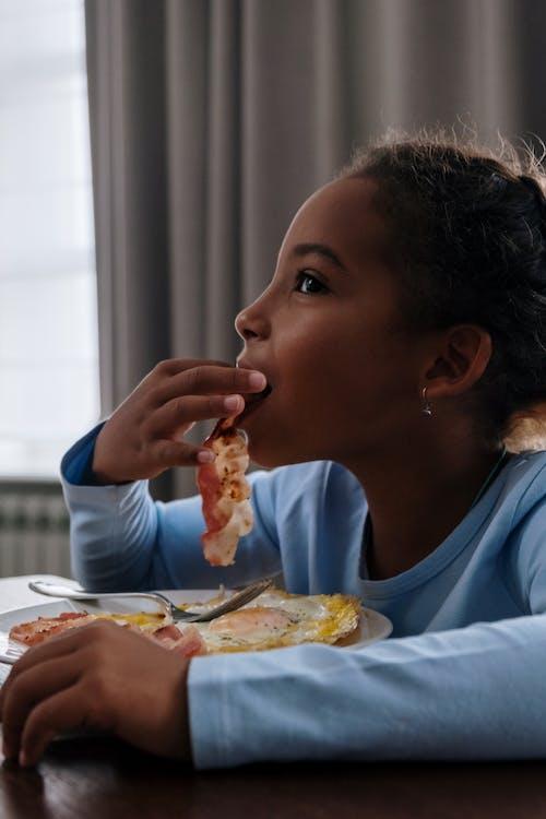 A Girl Eating Bacon