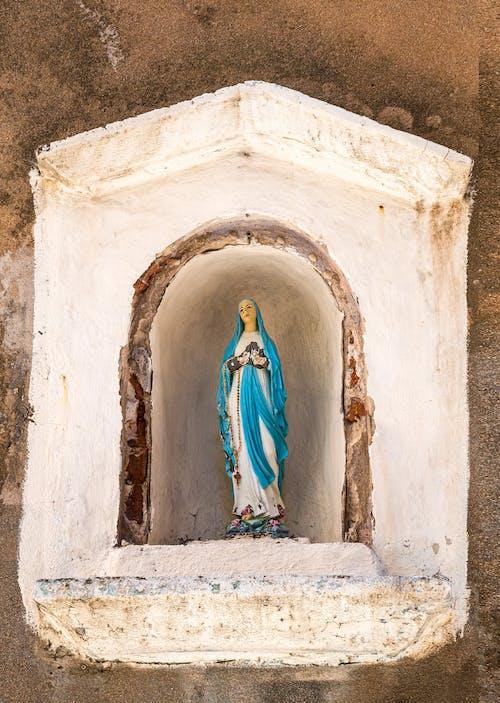 Virgin Mary Statue on White Concrete Altar