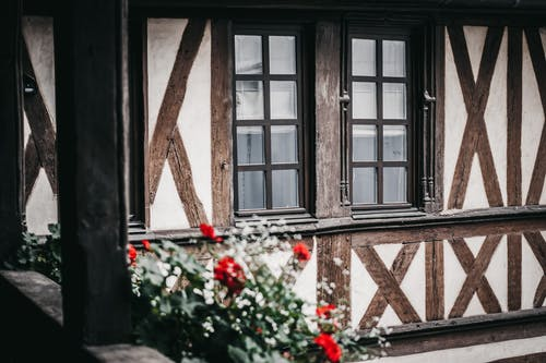 Exterior of residential cottage decorated with flowers
