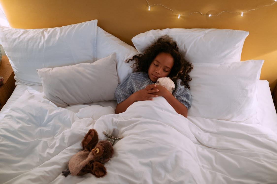 Girl in White Dress Lying on Bed