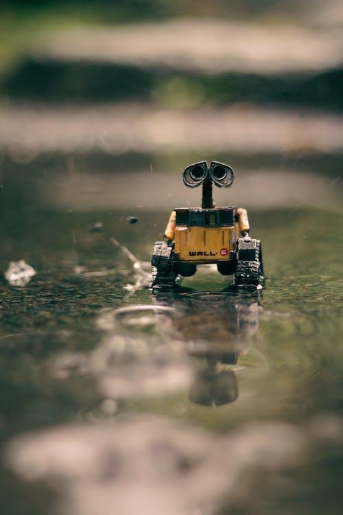Gratis lagerfoto af betongulv, legetøj, lodret