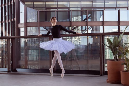 A Ballerina Standing on Her Toes