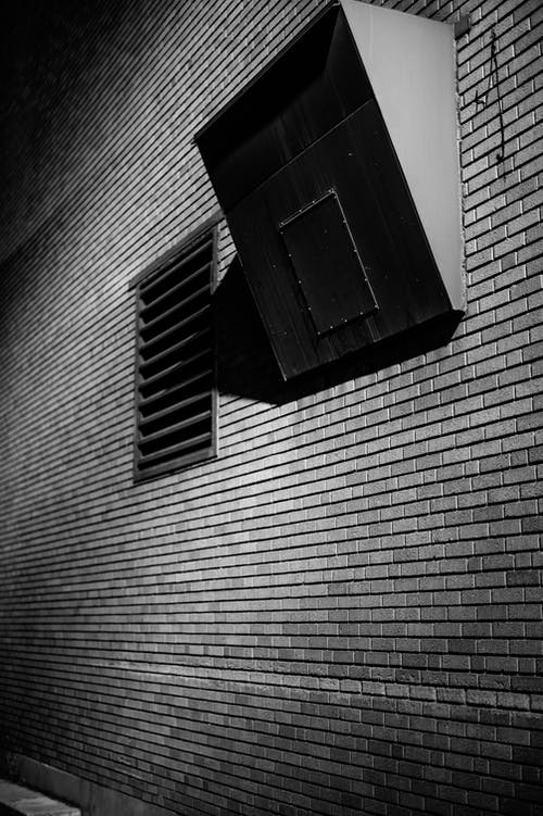 Brick wall of building with system of ventilation