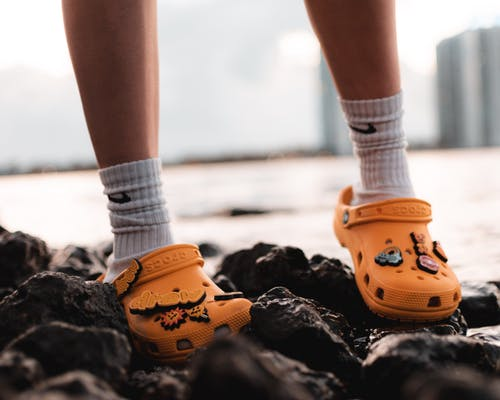 Person Wearing Yellow Crocs