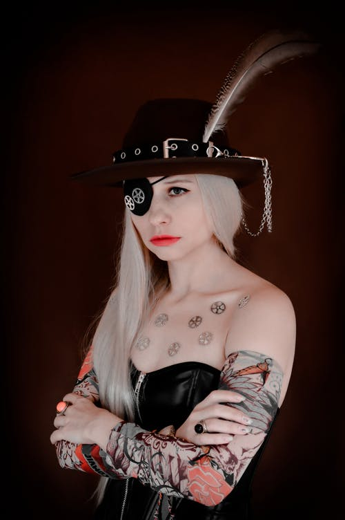 Serious woman with hands crossed in pirate costume