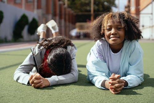 Multiethnic girls chilling on sports ground