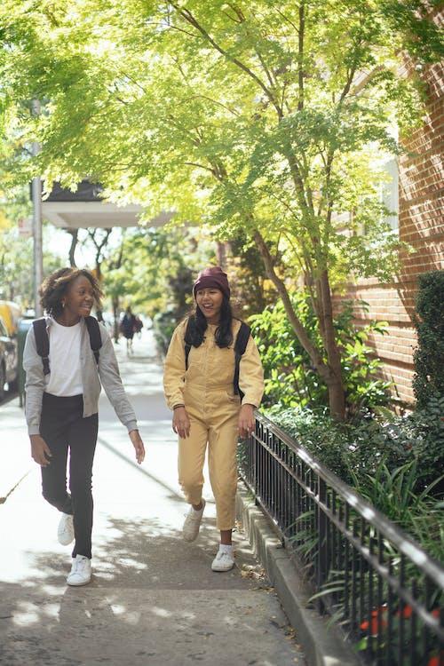 Cheerful diverse girls walking home