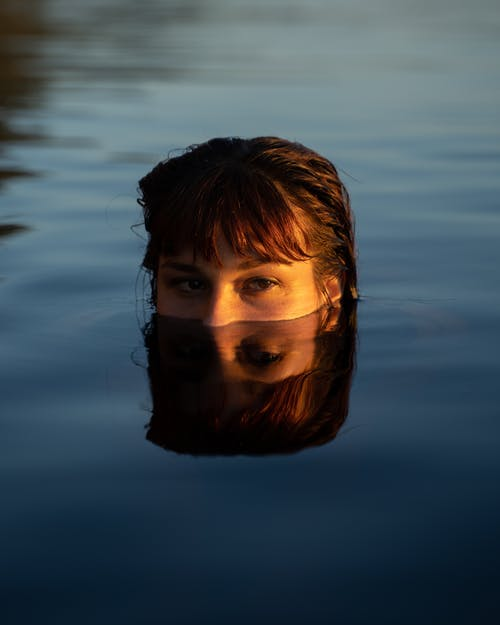 Womans Face on Water