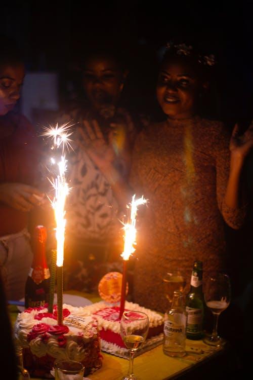 Free stock photo of birthday cake, champagne bottle, girls celebrating birthday