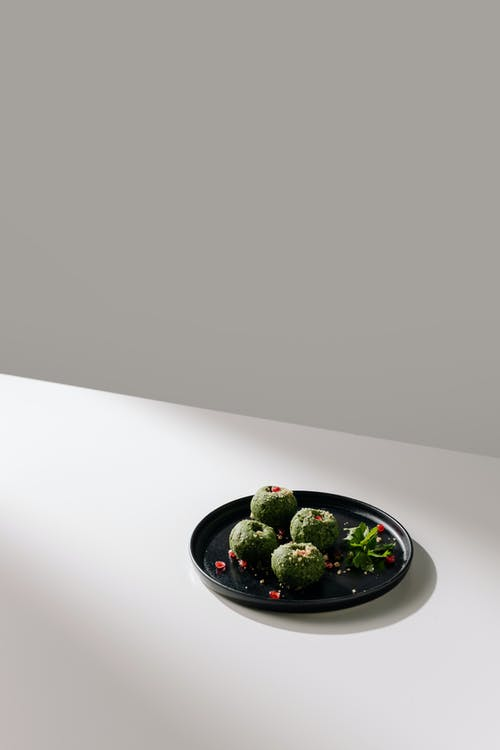 Spinach Pkhali on Black Plate