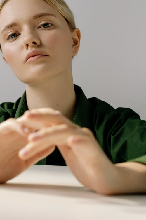 A Woman in Green Shirt Looking at the Camera