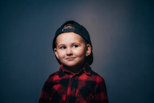 Boy in Red and Black Plaid Button Up Shirt