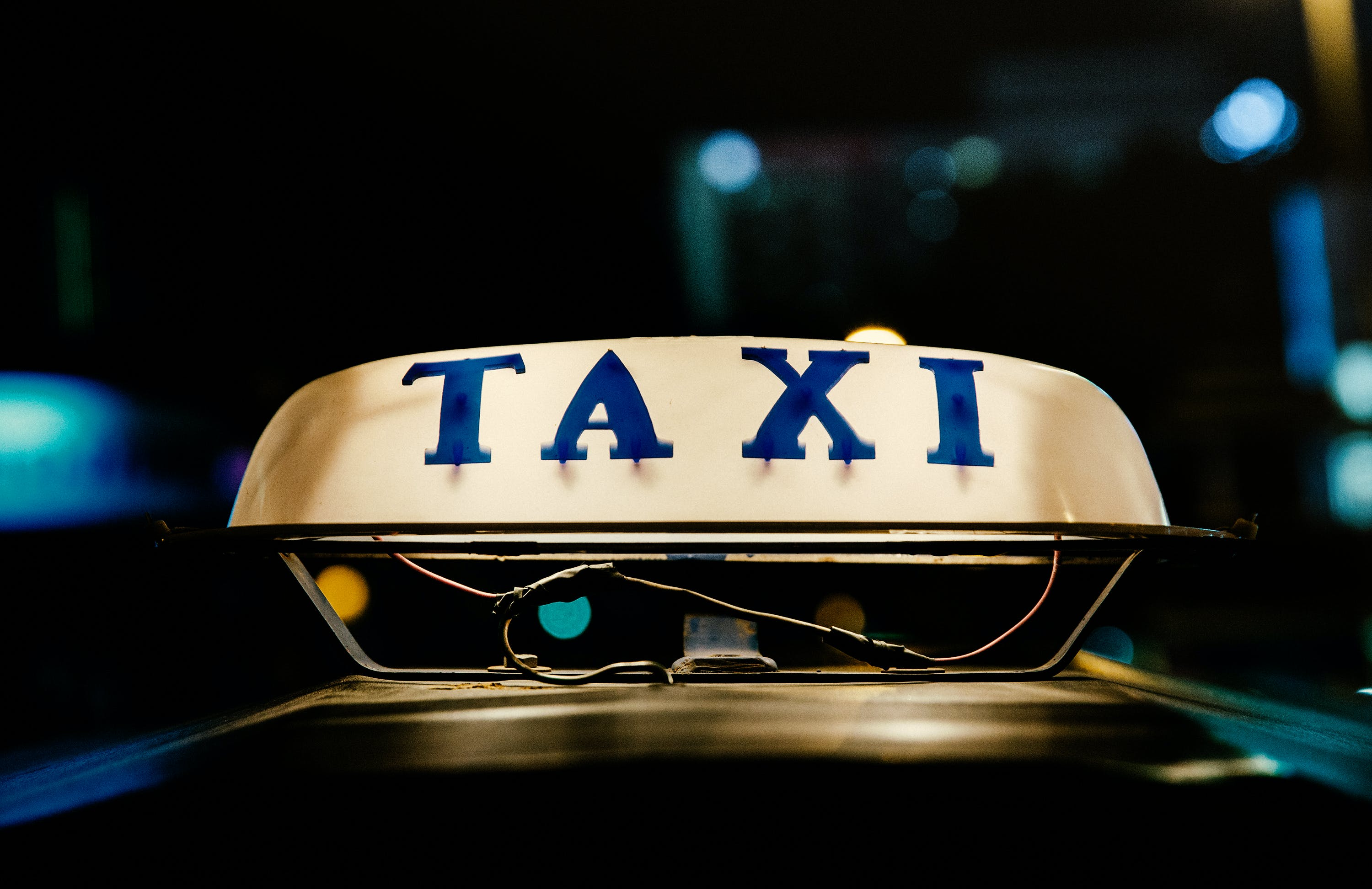 Macro Shot Photography of Taxi Lamp