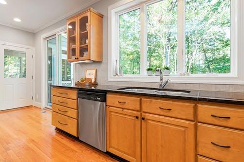 White Wooden Kitchen Cabinet Near Window