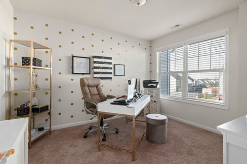 Brown Office Rolling Chair Beside White Wooden Desk