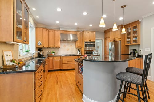 Brown Wooden Kitchen Cabinet and White Kitchen Counter