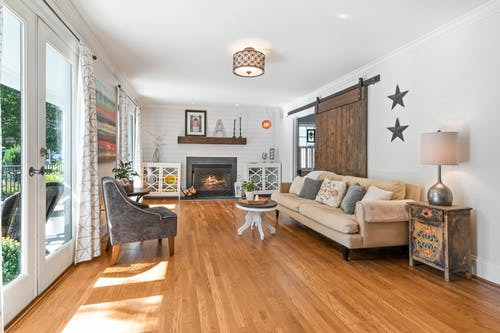 Living Room With White Sofa and Brown Wooden Floor