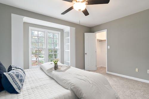 White Bed Near White Wooden Door
