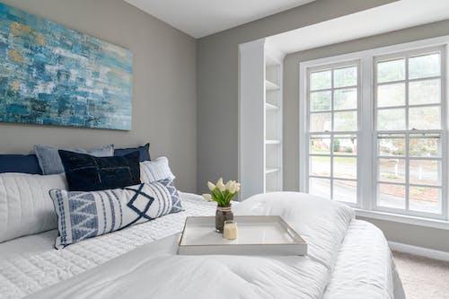 White Bed Near White Wooden Framed Glass Window