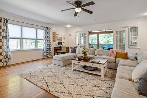 Living Room With White Sofa and Brown Wooden Coffee Table