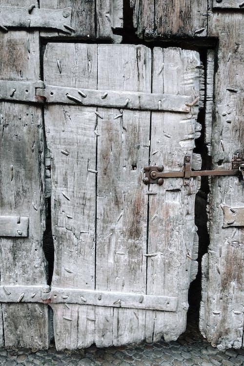 Old wooden door of rural construction