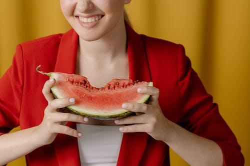Woman in Red Blazer Holding Watermelon