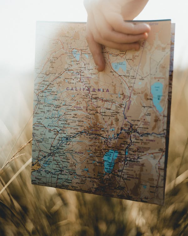 Person Holding Map of Usa