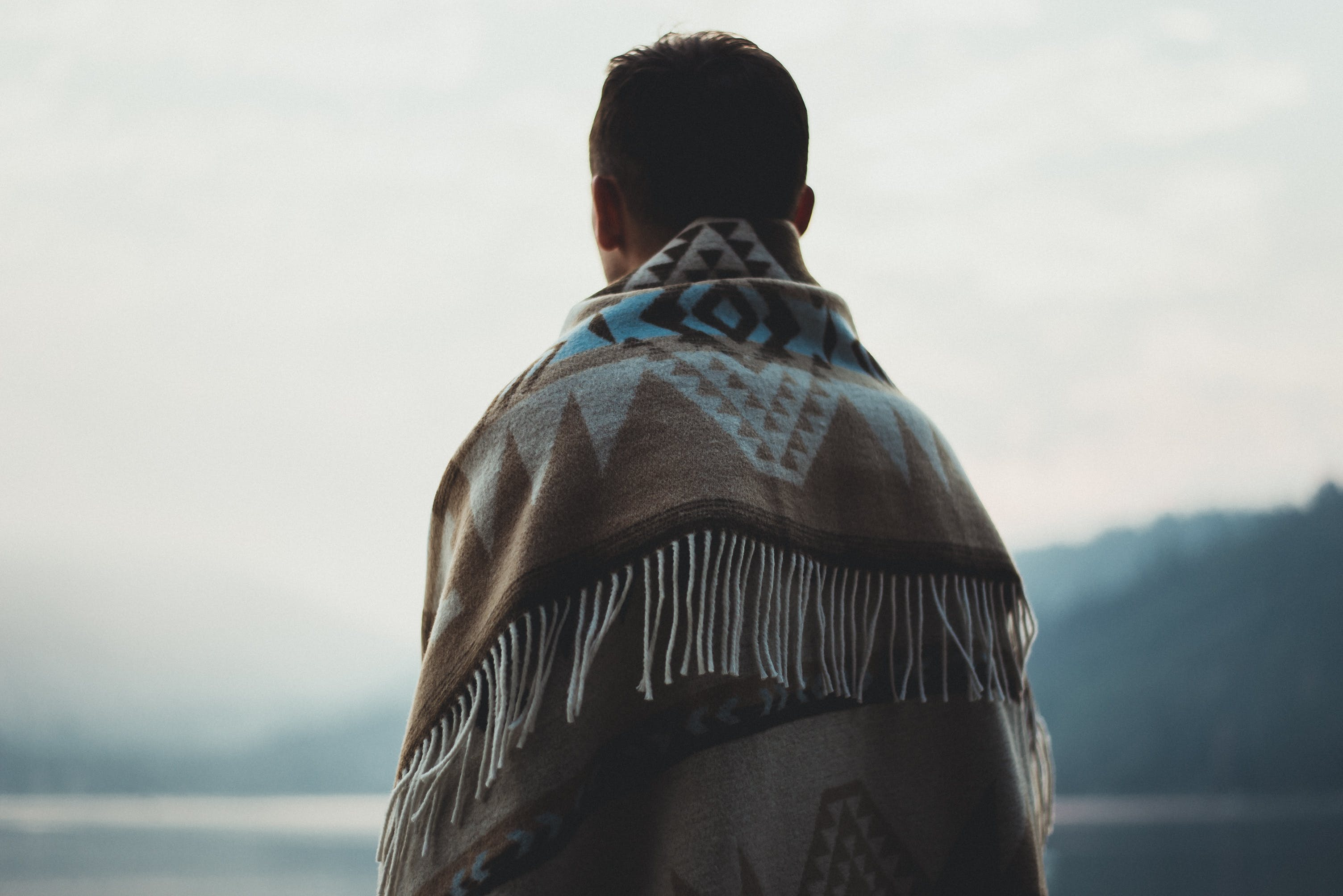 Person Wearing Brown Tribal Print Scarf