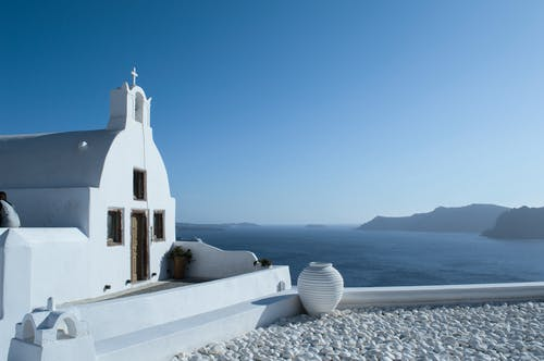 White Concrete Church Near Sea