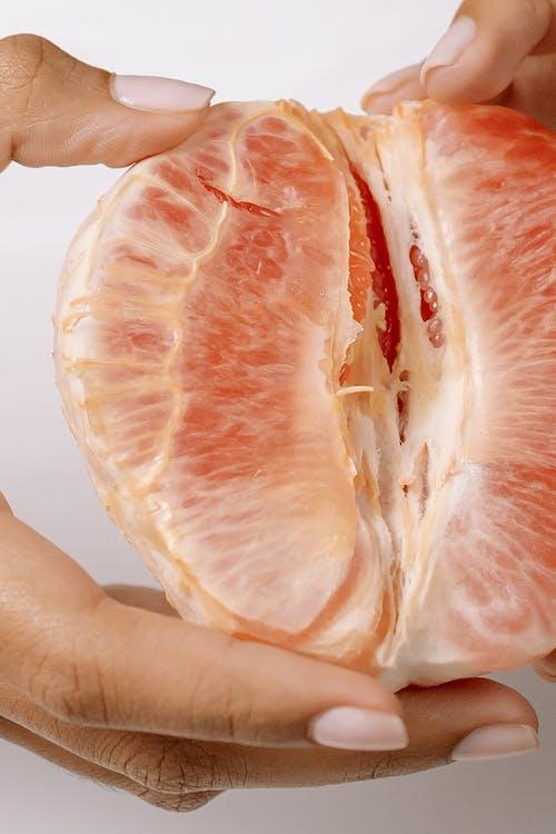 Person Holding Sliced Orange Fruit