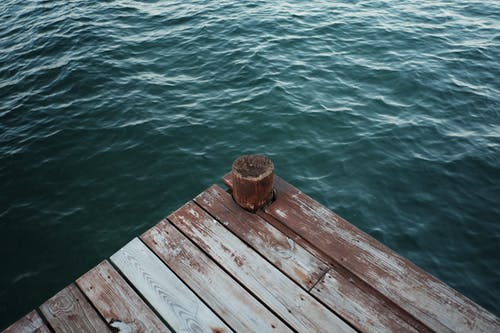 Dark Green Sea Water Wooden Pier