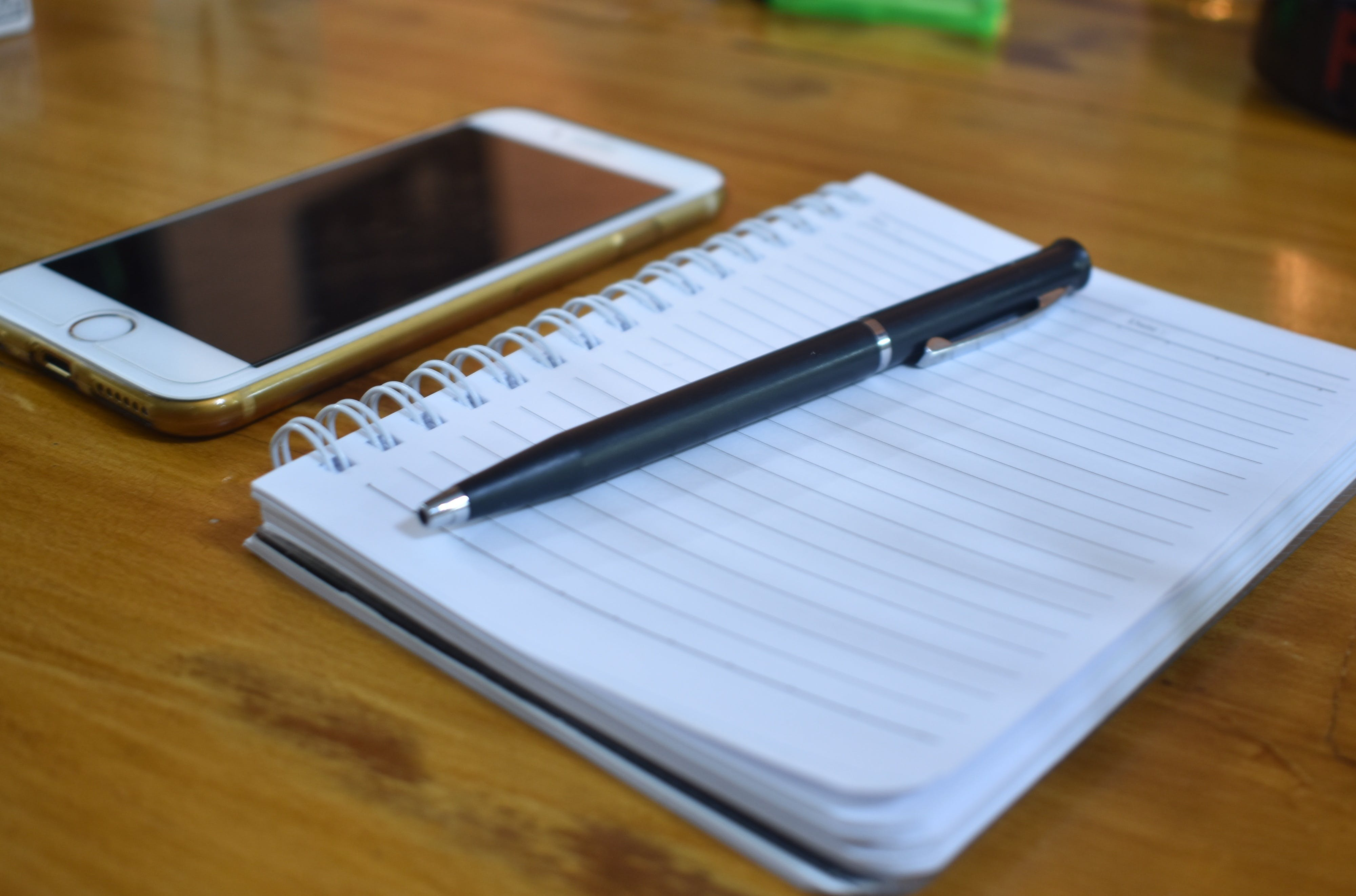 Free stock photo of business, notebook, notebook and smartphone, pen